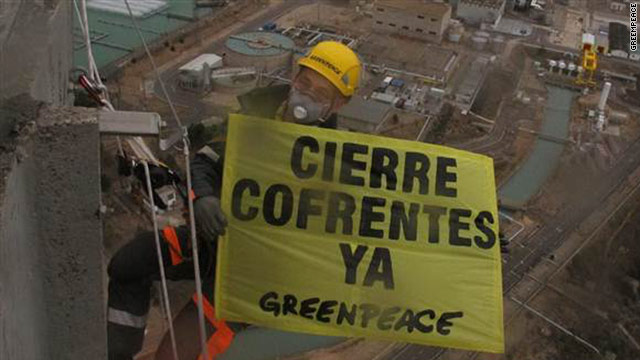 Greenpeace activists photograph themselves suspended from a tower at a nuclear power plant in Spain, February 15, 2011.