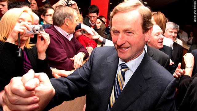 Enda Kenny, leader of the Fine Gael party, meets supporters as he arrives at the ballot count center in Castlebar on Saturday.
