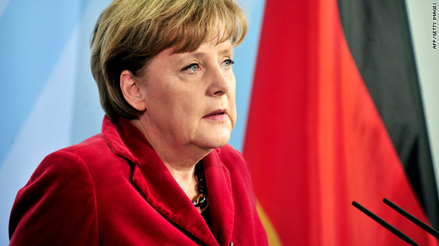 "German Chancellor Angela Merkel says she has accepted the defense minister's resignation ""with a heavy heart."""