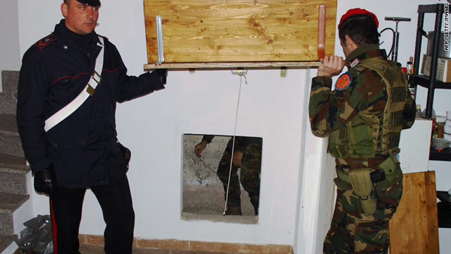 An Italian police photo shows the entrance to a hiding place where 'Ndrangheta boss Francesco Maisano was arrested.