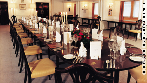 "One of the deluxe dining rooms on board ""Britannia,"" Queen Elizabeth II's former royal yacht."