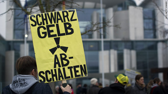 A protestor holds a placard reading 'Switch off nuclear power' during an anti-nuclear demonstration in Berlin on Monday.