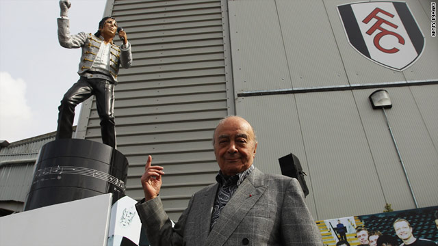 Fulham FC chairman Mohammed Al Fayed unveils the statue outside the club's London stadium.