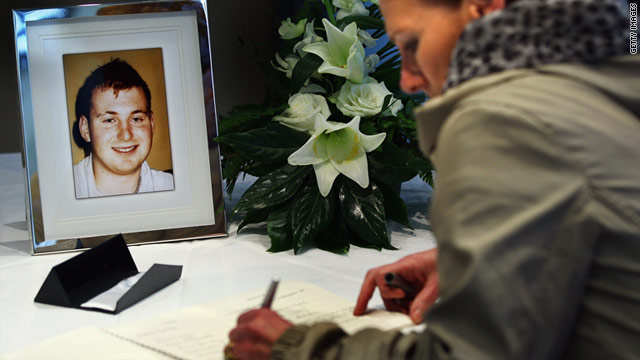 A book of condolences is signed under a photo of killed Northern Ireland police officer Ronan Kerr.