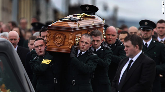 Police officers carry the coffin of Constable Ronan Kerr on Wednesday in Beragh, Northern Ireland. Kerr was killed by a bomb.