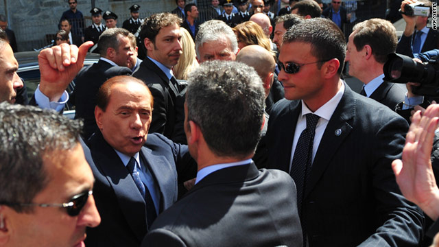 Italian PM Silvio Berlusconi addresses the crowd outside court in Milan on Monday -- he faces financial corruption charges.