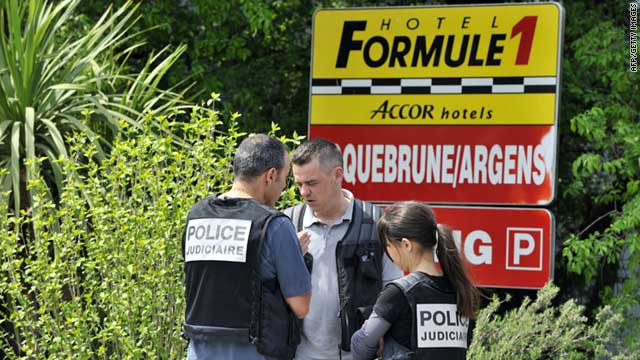 Policemen outside Formule 1 Hotel at Roquebrune-sur-Argens where the missing family's car was found.