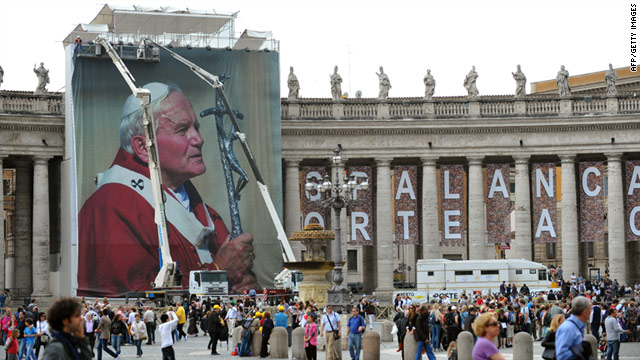 Workers set up a giant photo of John Paul II at Saint Peter's Square in Vatican City on Wednesday, April 27.