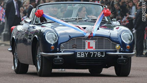 Royal newly-weds swap carriage for Aston Martin