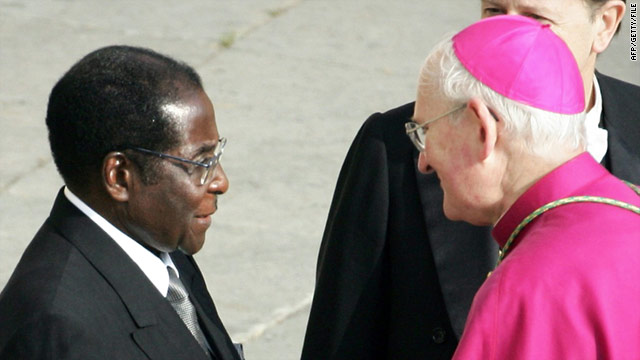Bishop James Harvey welcomes Robert Mugabe before the funeral of Pope John Paul II on April 8, 2005.