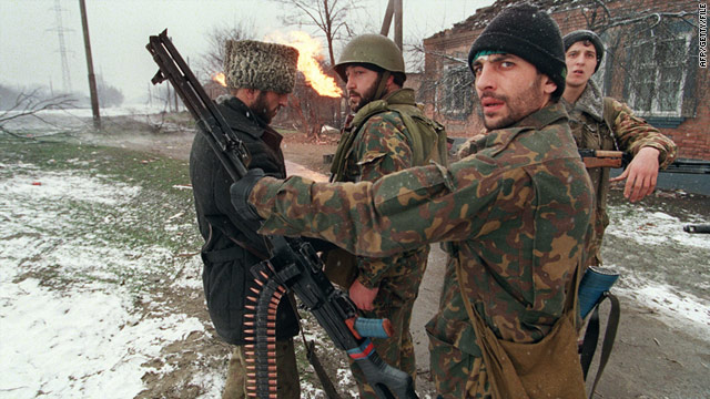 In this file photo, a Chechen fighter checks his weapon on January 17, 1995 on the outskirts of Grozny.