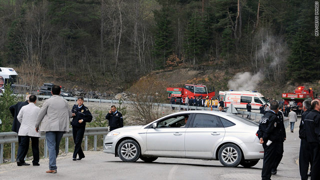 Police inspect the site of an attack on a convoy connected with Recep Tayyip Erdogan on Wednesday.