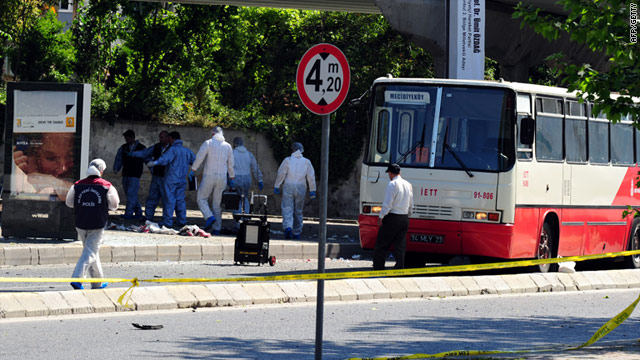 Turkish forensic police search the site after a small bomb attached to a bicycle exploded in Istanbul on Thursday.