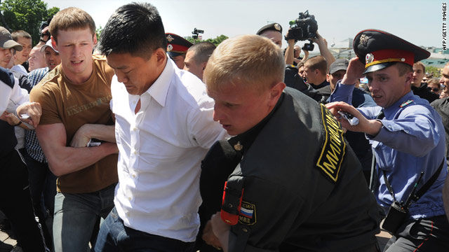 Russian police detain American gay rights activist Dan Choi on Saturday in central Moscow.