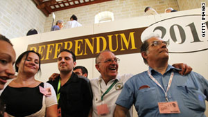 Green Party members announce the 'yes' vote in the poll to legalize divorce in Malta at a polling station in Valetta Sunday.
