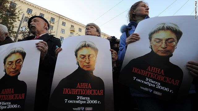 Russian human rights activists attend a rally in honour of slain journalist Anna Politkovskaya in Moscow on October 7, 2010.