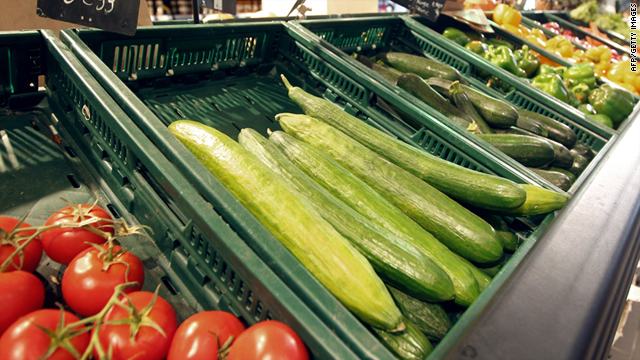 Tomatoes and cucumbers are displayed on May 30, 2011 in a stall in a supermarket in Paris.