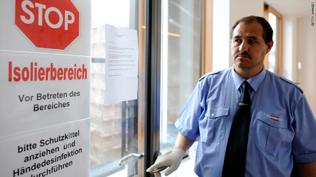 A sign at the entrance of a hospital isolation area in Hamburg, Germany, warns people of E. coli-infected patients.