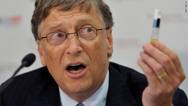Microsoft co-founder Bill Gates holds up a vaccination vial at the conference in London on Monday -- he pledged $1 billion.