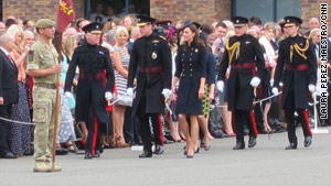 Prince William and Catherine, Duchess of Cambridge, Saturday in Windsor, on their way to a medal parade.