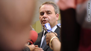 French Health Minister Xavier Bertrand addresses the E. coli outbreak in Bordeaux on Sunday.