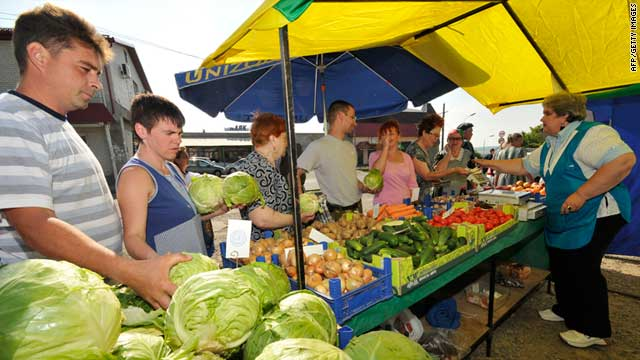 People buy vegetables and fruit at the market in Stavropol, south west Russia, on June 11, 2011.
