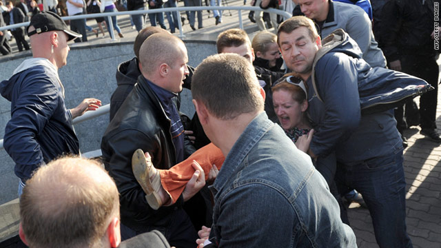 Plain clothed Belarusian policemen detain activists during Independence Day celebrations in Minsk on July 3.