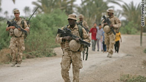 British officers patrol Basra in 2009 (Photo Courtesy of CNN/Getty Images).
