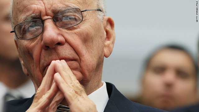 Experts say heads are likely to roll over the hacking scandal -- but Rupert Murdoch insists he is standing by Rebekah Brooks.
