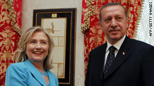 Secretary of State Hillary Clinton stands with Turkish Prime Minister Tayyip Erdogan.