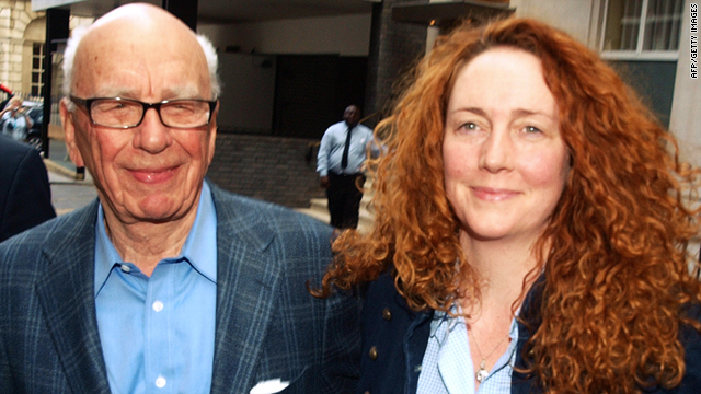 Rupert Murdoch (L) is pictured leaving his London residence with Rebekah Brooks (R) on July 10.