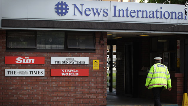 A policeman walks through the security gates at News International on July 7, 2011.