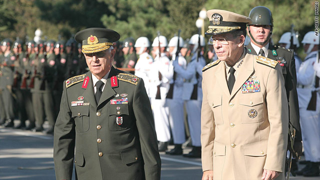 General Isik Kosaner (L) inspects an honor guard with U.S. Navy Admiral Mike Mullen (R) in Ankara last September.