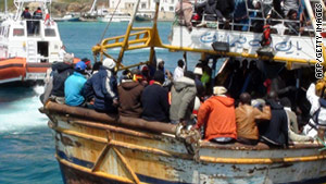 More than 30,000 refugees from Tunisia and Libya have risked this dangerous journey to Lampedusa in the last year.