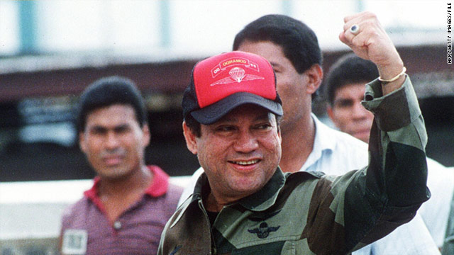 Manuel Noriega pictured in October 1989 waving as he left his headquarters in Panama City following a failed coup against him