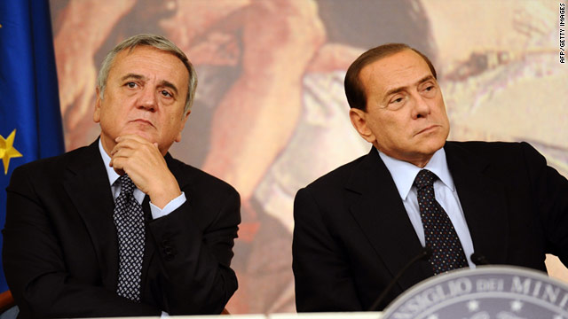Italian Prime Minister Silvio Berlusconi, right, and Labour Minister Maurizio Sacconi discuss Italy's slumping economy.