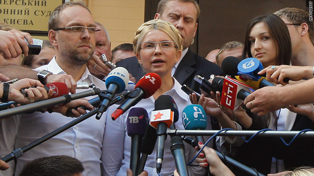 Ukraine's former prime minister Yulia Tymoshenko talks to press in front of a court building in Kiev before being arrested.