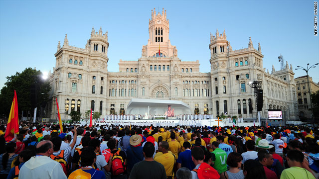 Pilgrims attend the inaugural mass of the World Youth Day at Cibeles square in Madrid on August 16.