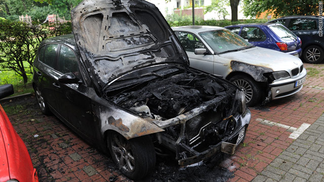 A burned-out BMW can be seen at a car park in Berlin.  A string of vandalism attacks have hit the capital in the past week.