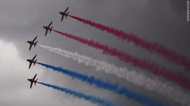 The Red Arrows display below dark skies at the annual RNAS Yeovilton Air Day on July 9, 2011 in Yeovil, England.