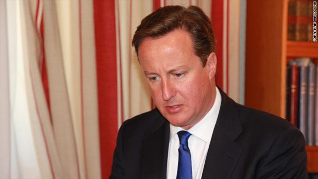 British Prime Minister David Cameron has sent a message to Libyan leader Moammar Gadhafi: Give yourself up, it's over.