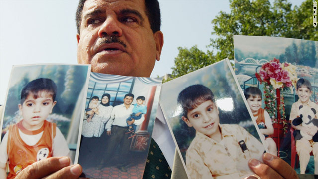 The father of Baha Mousa, who died at a British military base in Iraqi in 2003, shows photos of his son to the UK press in 2004.