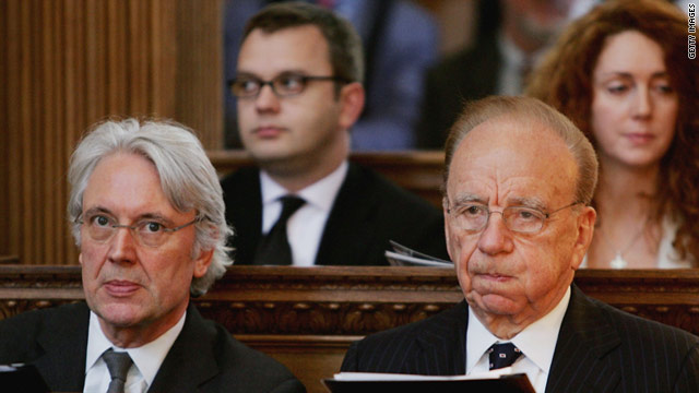Les Hinton (L) with Rupert Murdoch, Andy Coulson and Rebekah Brooks in London in 2005.