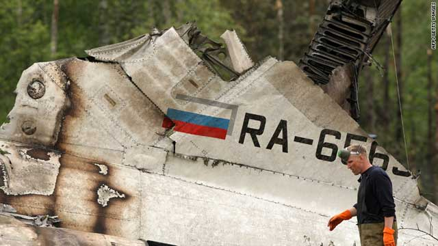 A rescue worker walks amid the debris of the Russian jet that went down on June 20 in Petrozavodsk, killing 47 people.
