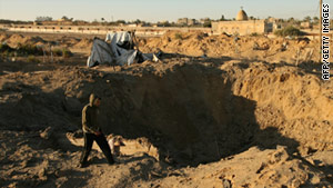 A Palestinian man inspects a smuggling tunnel damaged by an Israeli airstrike on Rafah in the southern Gaza Strip.
