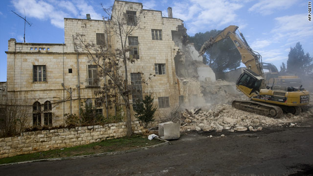 Israeli bulldozers demolish part of the Hotel Shepherd in  East Jerusalem Sunday to make way for 20 new homes for Jews.