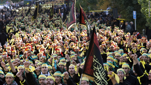 Hezbollah supporters take part in a parade in the city of Nabatiyeh in southern Lebanon on December 19, 2010