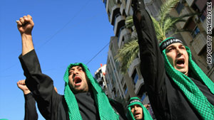 Hezbollah supporters march while shouting slogans in southern Beirut in December.