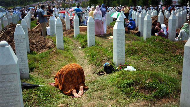 A woman prays during a mass burial for 775 newly identified victims of the 1995 Srebrenica massacre on July 11, 2010.
