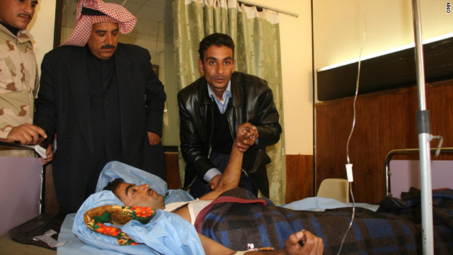 An injured man lies in a hospital in Tikrit, where a suicide bombing killed at least 65 people on Tuesday, January 18.